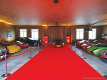 Recognized as one of Canada's most prestigious car collectors, Jim Williams displays his fleet of cars in a designer showroom garage with red-carpet ropes.