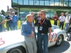 Jim Williams shares a moment with racing driver legend Stirling Moss, who was honoured in 2005 at Mille Miglia for coming out on top at its 1955 race.