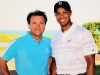 Venture capitalist Robert Herjavec with professional golf player, Tiger Woods.