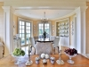 Floor-to-ceiling French doors lead from the breakfast nook to the west terrace garden