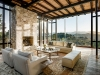 """Tehama 1: """"Light is at play everywhere, from the dappled light that hits the stone wall to the reflection of the majestic neighbouring tree in the house's expansive glass facade,"""" says Mary Ann Schicketanz 