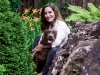 Amanda Lang takes a backyard break with her jogging partner Bella. Photography By Christoph Strube Of Judy Inc.