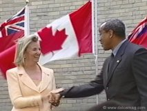 Hilary M. Weston shakes hands with Michael Lee-Chin.