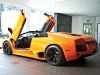Scissor door extended, this fiery Murciélago makes its presence known.