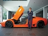 A striking orange Lamborghini Murciélago models with the supercar CEO Stephan Winkelmann.