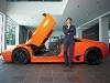 A striking orange Lamborghini Murciélago models with the supercar CEO Stephan Winkelmann.