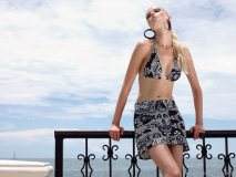 A modern take on classic black and white, this pretty bandana print bikini comes with a matching skirt, offering coverage in and out of the water. www.shan.ca
