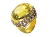 With a glittering yellow quartz atop orange, white and pink sapphires, this lemon topaz ring by Sazingg demands attention. www.vivre.com