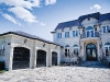 Custom homes like this colossal castle are a company specialty, resembling timeless designs both inside and out – just like Versaille's extravagant Les Grands appartments.