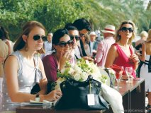 Polo enthusiasts are entertained by a close competition.