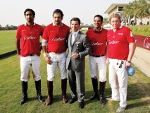 Louis Feria, managing director of Cartier Middle East and India, poses with Cartier's polo team.