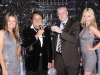 Russian Standard Vodka founder Roustam Tariko, left, raises his glass in the company of prominent guests.