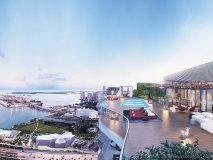 A rendering of one of the waterside decks of Auberge Miami, a condominium heavily focused on art and design
