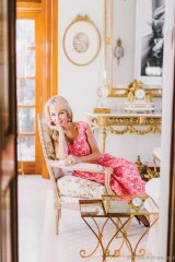 Suzanne Rogers takes a seat in her Forest Hill home. She wears a top and skirt by Simone Rocha