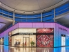 The two-storey LED screens at the entrance, whimsical touches and backlit mesh screens throughout make Louis Vuitton a retail destination of choice at Yorkdale | Photo Courtesty Of Louis Vuitton/Michael Muraz