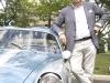 Andrea Zagato leans against Sean Collins\' 1958 Fiat Abarth Zagato 750GT Corsa.
