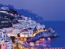 The sublime beauty of Amalfi Village shines at night. Photo by Robert Leon
