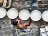 Artisan carrying ceramic plates in Ceramica Artistica Solimene ceramics factory, Vietri Sul Mare, Amalfi Coast. Photo by Robert Leon
