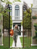 Francesca Bortolotto Possati, chairwoman and CEO of the Bauers Hotel Group, stands at the gates of Villa F, one of the various properties she's added to the Bauer umbrella over the years.
