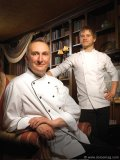 Executive chef Roland Ménard, left, and chef Francis Wolf in Manoir Hovey's stately library.