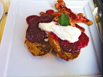 Chef Ménard\'s delectable breakfast of french toast,  fresh raspberries, orange peel and whipped cream.
