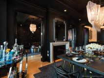 A double-sided fireplace overlooks the formal dining area of the Rockstar Suite
