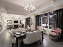 Living and dining room  of the Elegant Suite,  which features two bedrooms  and northwest views of  the city skyline