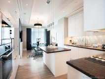 The Elegant Suite features a custom kitchen by Downsview, integrated Miele appliances and a fireplace