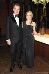 The William Vintage Dinner hosted by William Banks-Blaney and Gillian Anderson in association with Adler Joailliers. The actress-turned-fashionista wears earrings in white gold with Colombian emeralds and diamonds by Adler, and a 1970s black silk Halston dress from William Vintage PHOTO BY DAVE M. BENETT