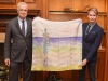 David Dixon and Dr. John Semple show off the gorgeous piece of artwork that is their silk scarf collaboration