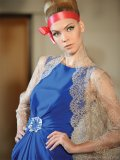 Lorenzo Riva\'s royal blue gown becomes even more regal with a cinched waist and lace shawl.