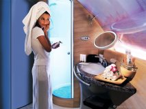 An onboard cocktail lounge and private shower spas give a whole new meaning to flying first class.