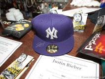 The silent auction includes a cap signed by Justin Bieber. Photo by Marisa Erin Photography.