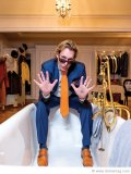 Michael Wekerle sits on the edge of his bathtub in the spacious master suite of his elegant Forest Hill home