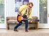 Wekerle rocks out poolside with a Gibson Les Paul autographed by Les Paul himself