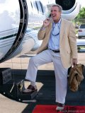 Venture capitalist Bobby Genovese takes a quick call before jet-setting from his home in the Bahamas to the BG Capital Group headquarters in Florida.