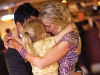 Rachel and Sonny express their love with daughter Rylee at their wedding ceremony.