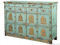 Tracy Porter\'s teal vintage chest, embellished with golden deities and Buddhas.