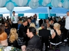 Gala-goers dine under a delightfully decorated tent.