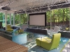 The family room includes a projection system with  roll-down screen and surround-sound
