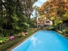 The backyard features a pool, landscaping designed by Walter Kehm and a phenomenal view of the Wolf House's three-storey glass façade