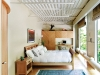 The second bedroom includes solar  shades and built-in pear wood cabinetry, closet and desk