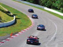 Porsche owners test their driving skills on the track