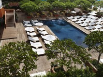 Aerial shot of The Modern Honolulu\'s Sunrise Pool, with its earthy wooden deck. Photography by: Evan Dion.