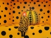 Kusama poses with Pumpkins Screaming About Love Beyond Infinity, one of her signature pieces | Photo Courtesy Of Yayoi Kusama