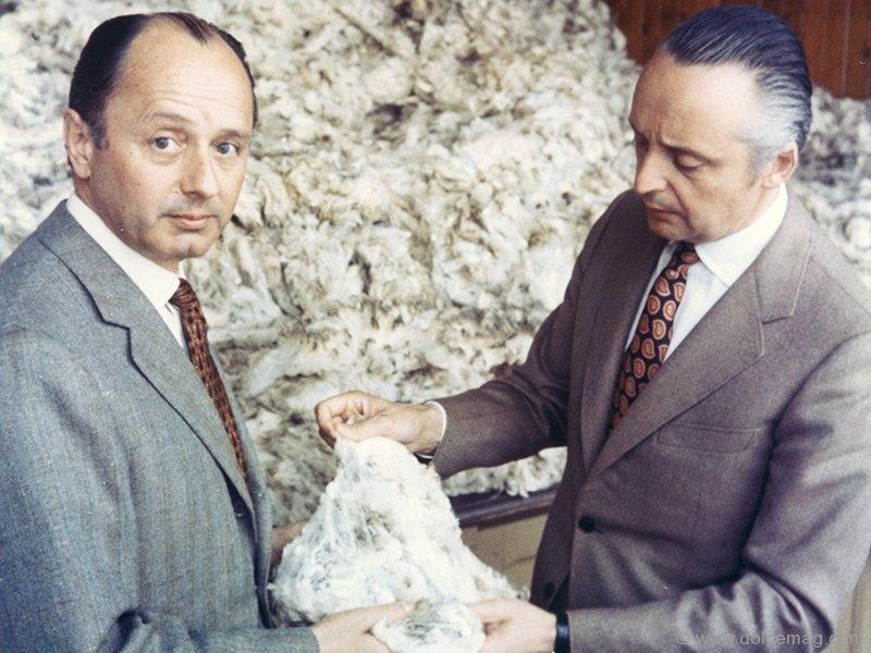 Aldo and Angelo Zegna, sons of Ermenegildo Zegna, inspect a piece of fine wool.